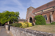 Photo by Andrew Tobin/Tobinators Ltd - 07710 761829 - St Martin's Church in the village of Witcham during the World Peashooting Championships held at Witcham, Cambridgeshire, UK on 13th July 2013. Run in conjunction with the village fair, the Championships have been held in Witcham since 1971 when they were started by a Mr Tyson, the village schoolmaster, in order to raise funds for the village hall.Competitors come from as far afield as the USA and New Zealand to attempt to win the event. The latest technology is often used, including laser sights and titanium and carbon fibre peashooters. All peashooters must conform to strict length rules, not exceeding 12 inches, and have to hit a target 12 feet away. Shooting 5 peas at a plasticine target attached to a hay bale, the highest scorers move through the initial rounds to a knockout competition, followed by a sudden death 10-pea shootout.