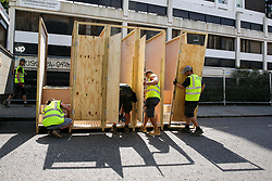 © Licensed to London News Pictures. 24/08/2019. London, UK. Workmen from Compoost Solutions install portable toilets up ahead of the 2019 Notting Hill Carnival which takes place this weekend and on bank holiday Monday. Up to 1 million people are expected to attend the biggest street party in Europe. Photo credit: Dinendra Haria/LNP
