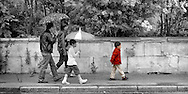 The light spring rain has no effect on the boy who marches to the beat of his own drum. This is walking in Croissy-sur-Seine, France.  Aspect Ratio 1w x 0.667h