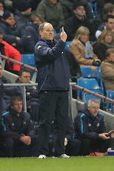 MANCHESTER, ENGLAND - WEDNESDAY, JANUARY 4th, 2006: Tottenham Hotspur's manager Martin Jol points the way to the top after watching his side beat Manchester City 2-0 during the Premiership match at the City of Manchester Stadium. (Pic by David Rawcliffe/Propaganda)