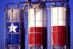 Three large storage tanks painted as the Texas flag