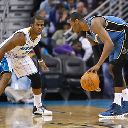 February 1, 2011; New Orleans, LA, USA; Washington Wizards point guard John Wall (2) is guarded by New Orleans Hornets point guard Chris Paul (3) during the first quarter at the New Orleans Arena.   Mandatory Credit: Derick E. Hingle