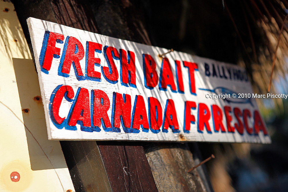 SHOT 12/7/10 7:09:59 AM - A sign advertising fresh bait at Mexi Divers in Tulum, Mexico. Tulum (Yucatec: Tulu'um) is the site of a Pre-Columbian Maya walled city serving as a major port for Cobá. One of the best-preserved coastal Maya sites, Tulum is today a popular site for tourists. The tourist destination is now divided into four main areas: the archaeological site, the pueblo (or town), the zona hotelera (or hotel zone) and the biosphere reserve of Sian Ka'an. (Photo by Marc Piscotty / © 2010)