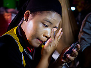 17 OCTOBER 2018 - BANGKOK, THAILAND:  A performer puts on her makeup before the Chinese opera on the last night of the Vegetarian Festival at Chit Sia Ma Shrine in Bangkok's Chinatown. The Vegetarian Festival, also called the Nine Emperor Gods Festival, is a nine-day Taoist celebration beginning on the eve of 9th lunar month of the Chinese calendar. Traditional Chinese operas, called Ngiew in Thailand, are sponsored at many Chinese shrines and temples during the Vegetarian Festival.   PHOTO BY JACK KURTZ