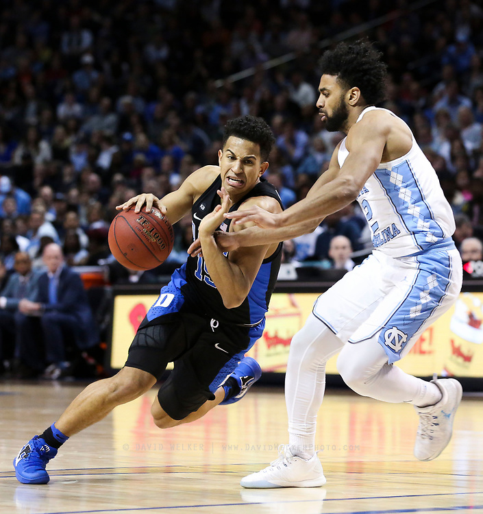 Duke guard Frank Jackson (15) drives past North Carolina guard Joel Berry II (2) during the semifinals of the 2017 New York Life ACC Tournament at the Barclays Center in Brooklyn, N.Y., Friday, March 10, 2017. (Photo by David Welker, theACC.com)