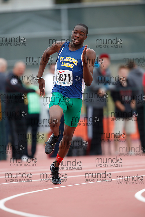 Rojae Rowe of St Joseph's CHS - Windsor competes in the 200m heats at the 2013 OFSAA Track and Field Championship in Oshawa Ontario, Saturday,  June 8, 2013.<br /> Mundo Sport Images/ Geoff Robins
