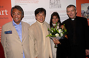 David Tang, Jackie Chan, Lucy Tang and Rev. Nicholas Holtan, Jackie Chan visits St. Martin-in-the-fields as a guest of David Tang to lend support to raise money for the renewal of the church and  chinese People's Day Centre. 20 June 2004. ONE TIME USE ONLY - DO NOT ARCHIVE  © Copyright Photograph by Dafydd Jones 66 Stockwell Park Rd. London SW9 0DA Tel 020 7733 0108 www.dafjones.com