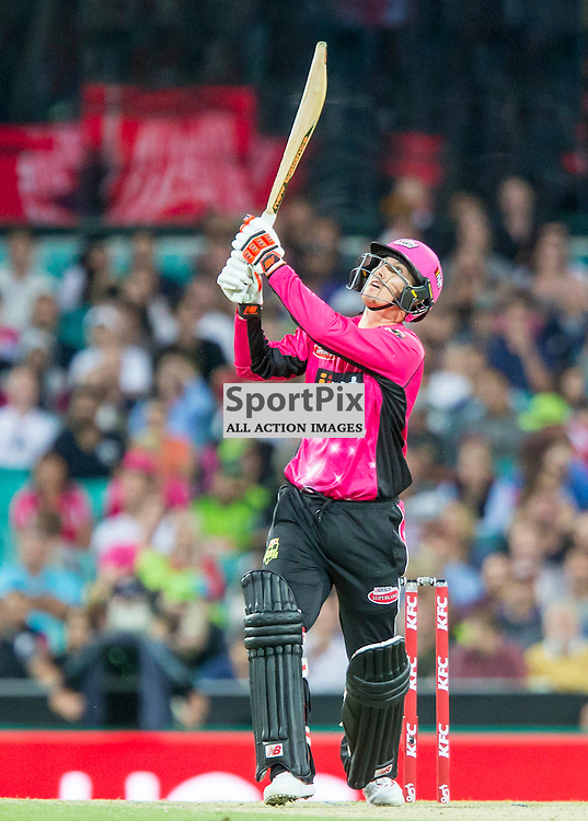 KFC Big Bash League T20 2015-16 , Sydney Sixers v Sydney Thunder, SCG; 16 January 2016<br /> Sydney Sixers Nic Maddinson smashes a 6 from the bowling of Sydney Thunder Andre Russell