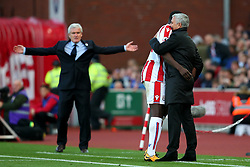 Manchester United manager Jose Mourinho shares a joke with his former player Kurt Zouma as Stoke City manager Mark Hughes reacts in frustration  - Mandatory by-line: Matt McNulty/JMP - 09/09/2017 - FOOTBALL - Bet365 Stadium - Stoke-on-Trent, England - Stoke City v Manchester United - Premier League