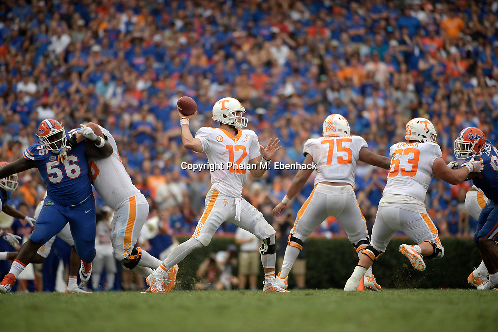 Tennessee quarterback Quinten Dormady (12) throws a pass during the second half of an NCAA college football game against Florida Saturday, Sept. 16, 2017, in Gainesville, Fla. Florida won 26-20. (Photo by Phelan M. Ebenhack)