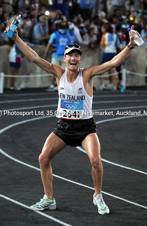 New Zealand marathon runner Dale Warrender poses for a photograph at the conclusion of his race inside Panathinkiko Stadium, Sunday 29 August 2004. Photo: Andrew Cornaga/PHOTOSPORT<br />
