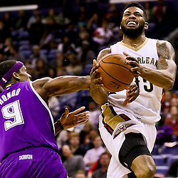 Jan 28, 2016; New Orleans, LA, USA; Sacramento Kings guard Rajon Rondo (9) fouls New Orleans Pelicans forward Alonzo Gee (15) during the second half of a game at the Smoothie King Center. The Pelicans defeated the Kings 114-105. Mandatory Credit: Derick E. Hingle-USA TODAY Sports