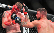 LAS VEGAS, NV - JULY 07:  Mike Perry (R) throws a punch at Paul Felder during their welterweight fight at T-Mobile Arena on July 7, 2018 in Las Vegas, Nevada. Perry won by split decision.  (Photo by Sam Wasson/Getty Images)