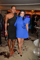 Left to right, singer SONIQUE and KIRAN SHARMA at a birthday dinner for Claire Caudwell for family & friends held at The Dorchester, Park Lane, London on 24th January 2014.