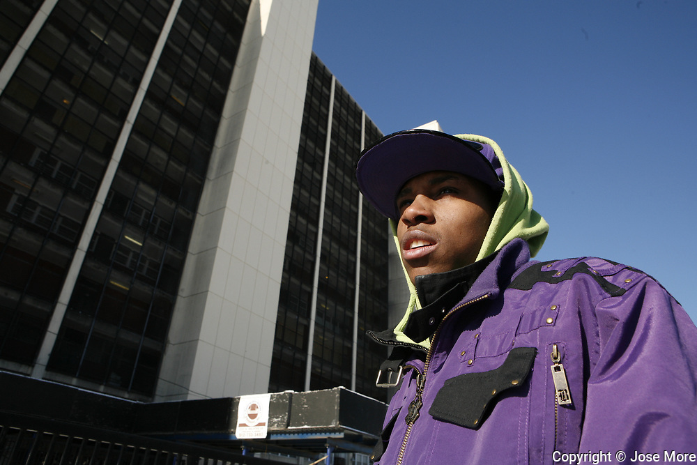 Raymond Ricks,19, outside the Cabrini Green building at 1230 N. Burling. Annie Ricks is the last family to reside in the public housing building behind them. The family moved out Thursday December 9, 2010.<br /> Photography by Jose More
