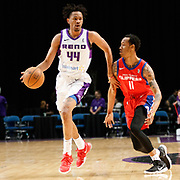 Reno Bighorns Forward LUIS MONTERO (44) drives against Agua Caliente Clippers Guard TIM QUARTERMAN (11) during the NBA G-League Basketball game between the Reno Bighorns and the Agua Caliente Clippers at the Reno Events Center in Reno, Nevada.