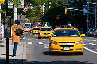 taxis and traffic on 5th avenue in New York City in October 2008