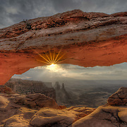 The sunrise through Mesa Arch is one of the classic American shots that all photographers want to get.  The arch itself is a lot smaller than you'd imagine and requires quite a drive from the nearest town so it was a very early start for me that day, but well worth it.