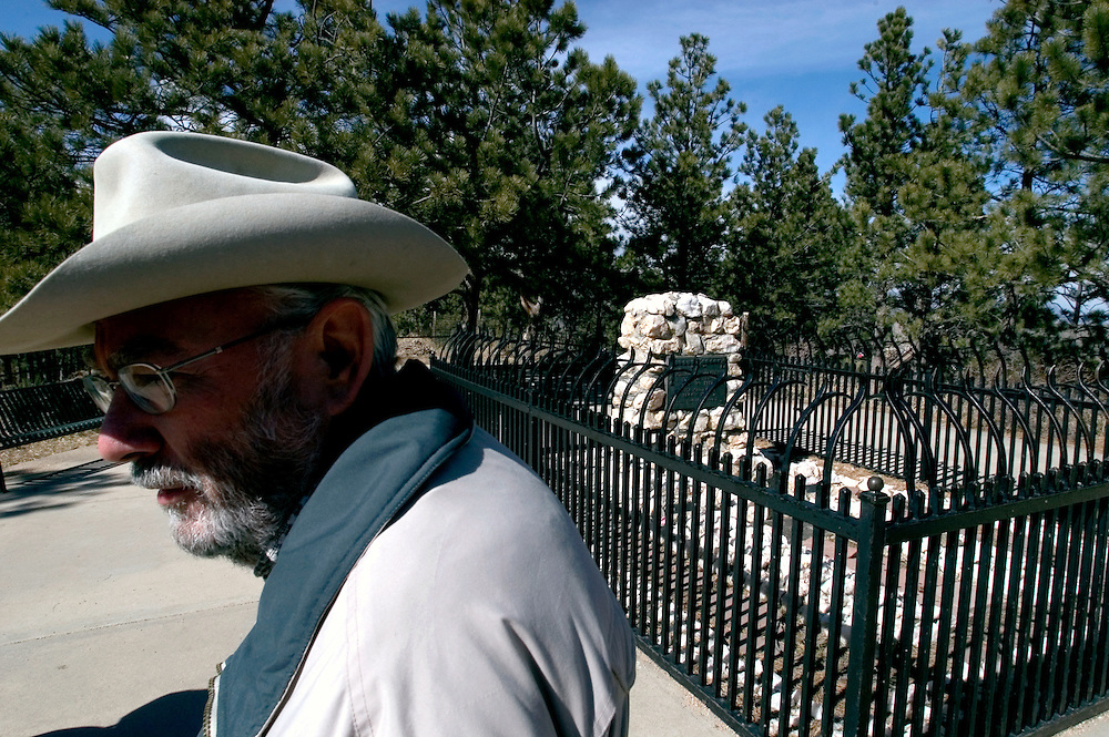 A Buffalo Bill impersanator walks past his grave at Lookout Mountain, Colorado