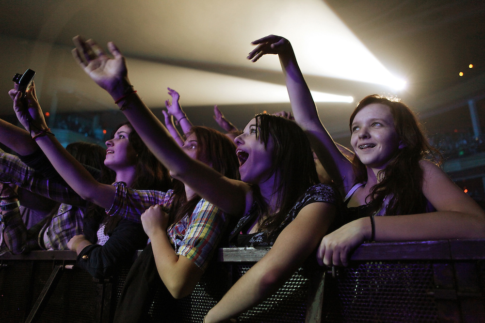 NEW YORK - DECEMBER 04:  Concert goers watch the performance of All Time Low at Hammerstein Ballroom on December 4, 2009 in New York City.  (Photo by Roger Kisby/Getty Images)