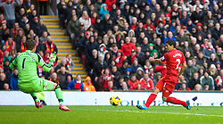 09.11.2013, Anfield, LIVERPOOL, ENG, Premier League, FC Liverpool vs FC Fulham, 11. Runde, im Bild Liverpool's Luis Suarez scores the third goal // during the English Premier League 11th round match between Liverpool FC and Fulham FC at Anfield in LIVERPOOL, Great Britain on 2013/11/09. EXPA Pictures &copy; 2013, PhotoCredit: EXPA/ Propagandaphoto/ David Rawcliffe<br /> <br /> *****ATTENTION - OUT of ENG, GBR*****
