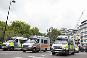 Police vans during the Football Lads Alliance march between Park Lane and Westminster Bridge, London on 7 October 2017. Photo by Phil Duncan.