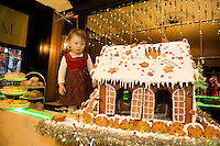 Jenny Mannion (1 1/2 years )   with a mouth - watering Gingerbread House, currently on display in the hotels elegant lobby that will be delivered to the hospital on Christmas Eve as a special delight for children & their families who regrettably have to spend the holiday season in hospital.  Photo:Andrew Downes