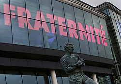 © Licensed to London News Pictures. 18/11/2015. London, UK The Bobby Moore statue outside Wembley stadium stands below the French national motto of Liberté, égalité, fraternité displayed ahead of the England v France football match. Photo credit: Peter Macdiarmid/LNP