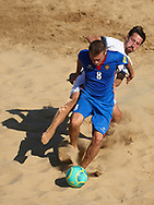 CATANIA, ITALY - AUGUST 16: Corneliu Pavalachi of Moldova competes for the ball with Kevin Sooaluste of Estonia during the Euro Beach Soccer League match between Moldova and Estonia on August 16, 2019 in Catania, Italy. (Photo by Quality Sport Images