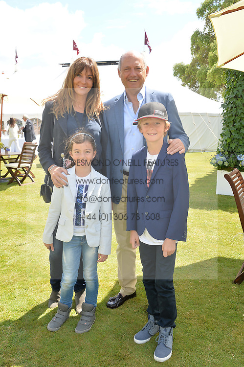 RON DENNIS and CAROL WEATHERALL with her children LOLA & ALEX at the Cartier hosted Style et Lux at The Goodwood Festival of Speed at Goodwood House, West Sussex on 29th June 2014.