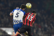 Lewis Dunk (5) of Brighton and Hove Albion and Callum Wilson (13) of AFC Bournemouth battles for possession during the Premier League match between Bournemouth and Brighton and Hove Albion at the Vitality Stadium, Bournemouth, England on 21 January 2020.