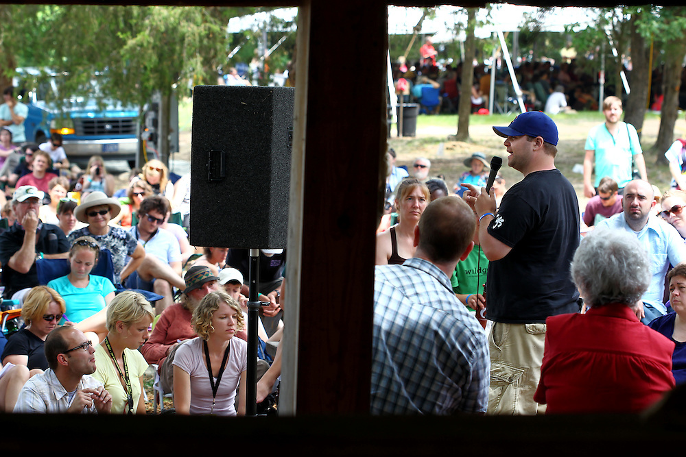 Andrew Marin, at right in hat, speaks in a panel discussion on sexuality and justice at the Wild Goose Festival at Shakori Hills in North Carolina June 25, 2011.  (Photo by Courtney Perry)