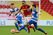 Nottingham Forest forward Dexter Blackstock and Queens Park Rangers midfielder Massimo Luongo challenge for the ball during The FA Cup third round match between Nottingham Forest and Queens Park Rangers at the City Ground, Nottingham, England on 9 January 2016. Photo by Aaron Lupton.
