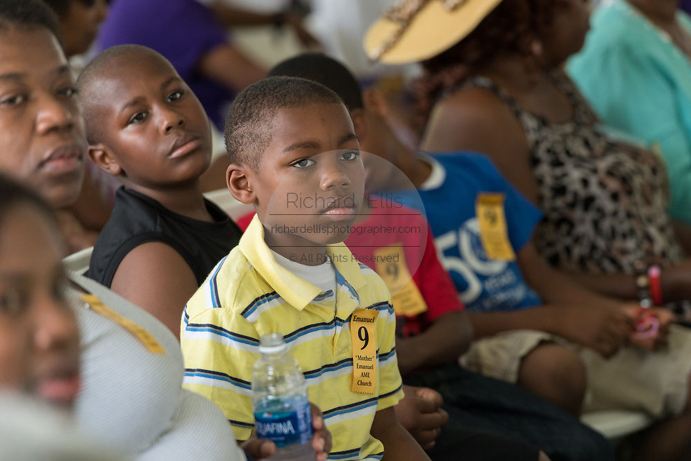 Young family members of victims of the Mother Emanuel African Methodist Episcopal Church massacre during a memorial service marking the 2nd anniversary of the mass shooting June 17, 2017 in Charleston, South Carolina. Nine members of the historic African-American church were gunned down by a white supremacist during bible study on June 17, 2015.