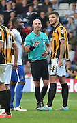 referee Darren Drysdale speaks to bury goal scorer Nathan Cameron and Ryan Inniss during the Sky Bet League 1 match between Bury and Port Vale at Gigg Lane, Bury, England on 19 September 2015. Photo by Mark Pollitt.