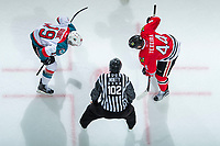 KELOWNA, CANADA - APRIL 8: Linesman Dustin Minty prepared to drop the puck at the face off between Dillon Dube #19 of the Kelowna Rockets and Keoni Texeira #44 of the Portland Winterhawks on April 8, 2017 at Prospera Place in Kelowna, British Columbia, Canada.  (Photo by Marissa Baecker/Shoot the Breeze)  *** Local Caption ***