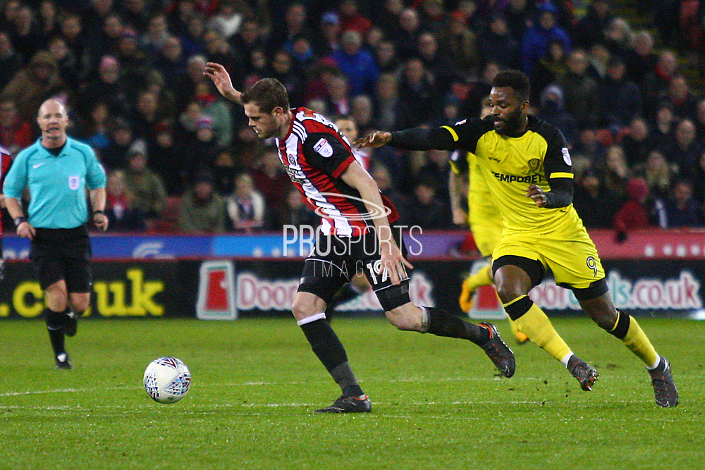 Burton Albion's Darren Bent chases Sheffield United's Richard Stearman during the EFL Sky Bet Championship match between Sheffield United and Burton Albion at Bramall Lane, Sheffield, England on 13 March 2018. Picture by John Potts.