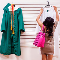 051613       Cable Hoover<br /> <br /> Gallup Catholic High School graduate Amber Lasiloo hangs her gown with others as she prepares for her graduation ceremony at El Morro Theater Thursday in Gallup.