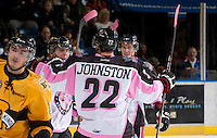 KELOWNA, CANADA - OCTOBER 20: Tyson Baillie #24, MacKenzie Johnston #22 and Filip Vasko #10 of the Kelowna Rockets celebrate a goal on the ice against the  Brandon Wheat Kings at the Kelowna Rockets on October 20, 2012 at Prospera Place in Kelowna, British Columbia, Canada (Photo by Marissa Baecker/Shoot the Breeze) *** Local Caption ***