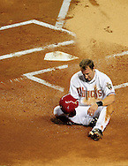 Jul. 15 2011; Phoenix, AZ, USA; Arizona Diamondbacks outfielder Willie Bloomquist (18) reacts at home plate after being thrown out at home during the first inning against the Los Angeles Dodgers at Chase Field. The Dodgers defeated the Diamondbacks 6-4. Mandatory Credit: Jennifer Stewart-US PRESSWIRE