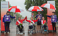 Sandra Graf (SUI) second place winner, Karen Darke (GBR) the first placed rider and Jennifer Browning (GBR) the third placed rider at the medal ceremony for the Womens Handcycle Classic at Prudential RideLondon, the world&rsquo;s greatest festival of cycling, involving 70,000+ cyclists &ndash; from Olympic champions to a free family fun ride - riding in five events over closed roads in London and Surrey over the weekend of 9th and 10th August. <br /> <br /> Photo: Neil Turner for Prudential Ride London<br /> <br /> Sunday 10th August 2014<br /> <br /> See www.PrudentialRideLondon.co.uk for more.<br /> <br /> For further information: Penny Dain 07799 170433<br /> pennyd@ridelondon.co.uk