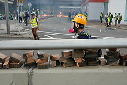 Hong Kong. 1 October 2019. After a peaceful march through Hong Kong Island by an estimated 100,000 pro democracy supporters, violent flared up at Tamar, Admiralty and moved through Wanchai district. Police used teargas and baton rounds and water cannon. Hard core group lit fires, threw bricks and Molotov cocktails at police. Violence continues into evening.Bricks to be used against the police. Iain Masterton/Alamy Live News.