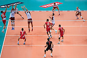 (L) Emre Batur from Turkey attacks against Lukasz Zygadlo and Piotr Nowakowski both from Poland during the 2013 CEV VELUX Volleyball European Championship match between Poland and Turkey at Ergo Arena in Gdansk on September 20, 2013.<br /> <br /> Poland, Gdansk, September 20, 2013<br /> <br /> Picture also available in RAW (NEF) or TIFF format on special request.<br /> <br /> For editorial use only. Any commercial or promotional use requires permission.<br /> <br /> Mandatory credit:<br /> Photo by &copy; Adam Nurkiewicz / Mediasport