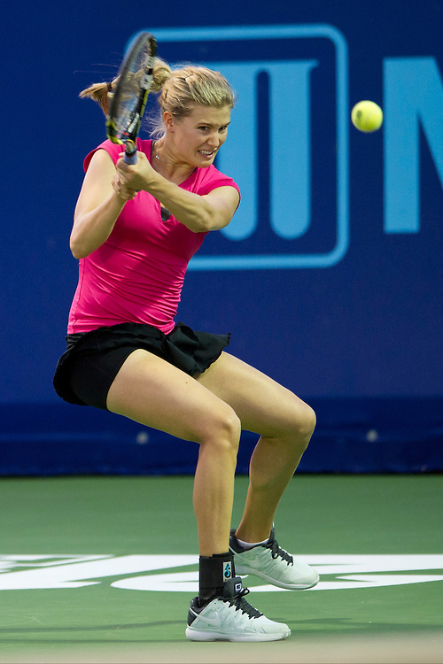 IRVING, TX - JULY 10:  Eugenie Bouchard of the Texas Wild returns the ball against the Washington Kastles on July 10, 2013 at the Four Seasons Resort and Club in Irving, Texas.  (Photo by Cooper Neill/Getty Images) *** Local Caption *** Eugenie Bouchard