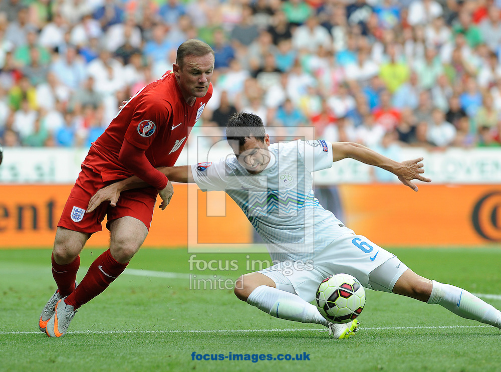 Branko Ilic of Slovenia and Wayne Roioney of England during the UEFA Euro 2016 Qualifying match at Stozice Stadium, Ljubljana<br /> Picture by Stefano Gnech/Focus Images Ltd +39 333 1641678<br /> 14/06/2015