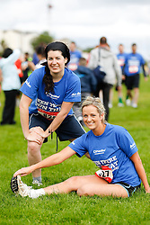 06/08/2012 No fee for Repro: Clare McGinley from Kiliney and Nicola Long from Shankill pictured warning up for the DLR Bay 10K road race. Pic Jason Clarke Photography