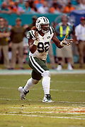 New York Jets defensive end Leonard Williams (92) claps his hands as he celebrates after stopping a first quarter run on third down and forcing a punt during the NFL week 9 regular season football game against the Miami Dolphins on Sunday, Nov. 4, 2018 in Miami Gardens, Fla. The Dolphins won the game 13-6. (©Paul Anthony Spinelli)