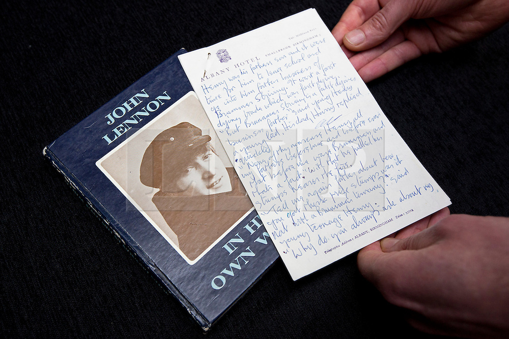"""© Licensed to London News Pictures. 21/03/2014. London, UK. """"Henry and Harry' (est. GB£18,000-24,000 - circa 1963) a handwritten piece by the late Beetles singer John Lennon on dreams of becoming famous, is shown next to the book it was written for (In His Own Words) during the press view for a new sale at Sotheby's auction house in London today (21/03/2014). The auction, entitled """"You Might Well Arsk"""", features original drawings and manuscripts by the singer from 1964-1965. Photo credit: Matt Cetti-Roberts/LNP"""