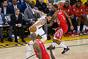 Golden State Warriors guard Stephen Curry (30) handles the ball against Houston Rockets forward Trevor Ariza (1) during Game 3 of the Western Conference Finals at Oracle Arena in Oakland, Calif., on May 20, 2018. (Stan Olszewski/Special to S.F. Examiner)