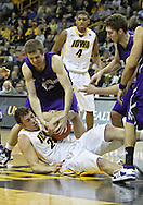 January 12 2010: Iowa Hawkeyes forward Andrew Brommer (20) and Northwestern Wildcats forward John Shurna (24) battle for the ball during the first half of an NCAA college basketball game at Carver-Hawkeye Arena in Iowa City, Iowa on January 12, 2010. Northwestern defeated Iowa 90-71.